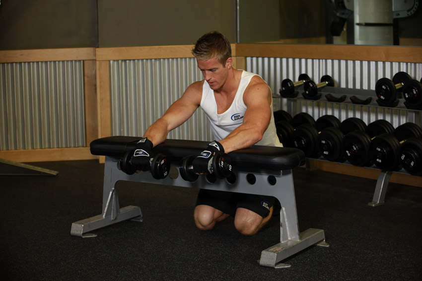 Palms-Down Dumbbell Wrist Curl Over A Bench 1